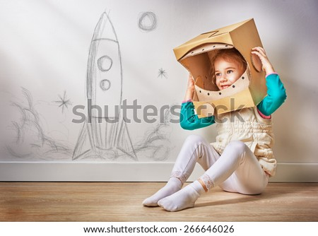 child is dressed in an astronaut costume #266646026