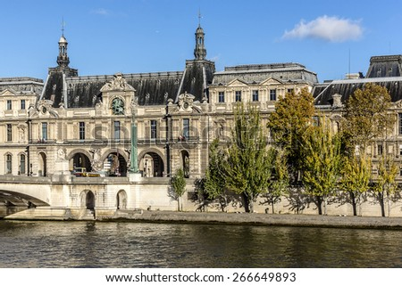 PARIS, FRANCE - NOVEMBER 12, 2014: View of famous Louvre Museum from the Seine river. Louvre Museum is one of the largest and most visited museums worldwide. #266649893