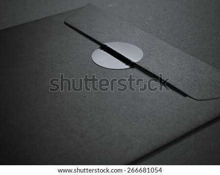Black envelope with blank sticker