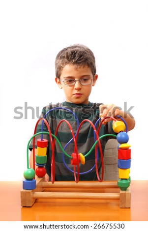 Little boy playing with colorful blocks #26675530