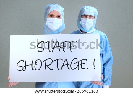 Two Doctors with shield staff shortage #266981183