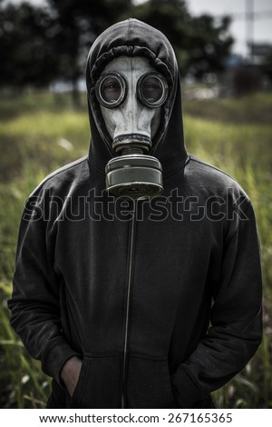 Portrait of human wearing hoodie and gas-mask #267165365