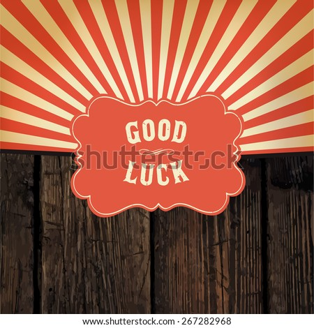 "Wild west styled ""Good Luck"" message on wooden board. With red rays background"