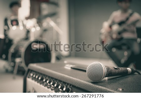 Closeup of microphone on musician blurred background Royalty-Free Stock Photo #267291776