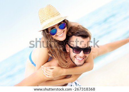 A picture of a happy couple having fun at the beach