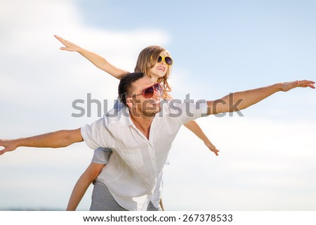 summer holidays, children and people concept - happy father and child in sunglasses over blue sky #267378533