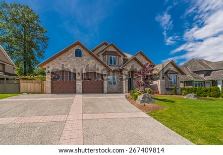 Big custom made luxury house with nicely landscaped front yard and driveway to garage in the suburb of Vancouver, Canada. #267409814