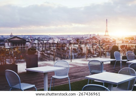 sunny terrace of restaurant in Paris with panoramic view on Eiffel tower, France #267436961