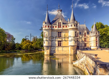 Chateau de Azay-le-Rideau in Loire Valley, France. Old castle of Azay-le-Rideau is one of the French Renaissance chateaux and landmark of Europe. Scenic view of the nice medieval mansion in summer. #267448334