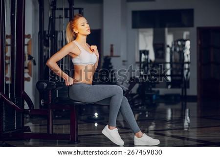 Beautiful blonde doing gym exercises #267459830