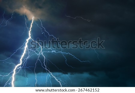 Fork lightning striking down during summer storm. Royalty-Free Stock Photo #267462152