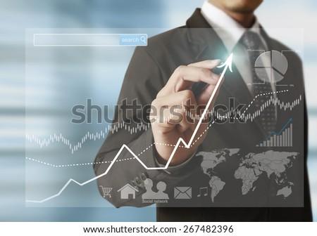 businessman hand writing a business graph  #267482396