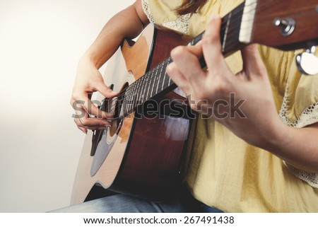 woman's hands playing guitar, close up. Vintage tone #267491438