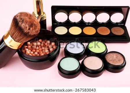 Set of decorative cosmetics on light colorful background #267583043