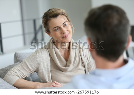 Couple at home sitting in sofa and having a talk #267591176