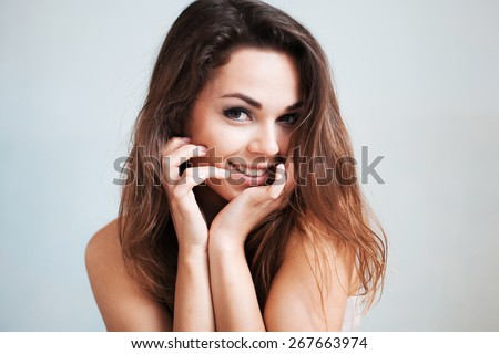 The beautiful young woman gently smiles #267663974