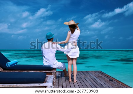 Couple on a tropical beach jetty at Maldives #267750908