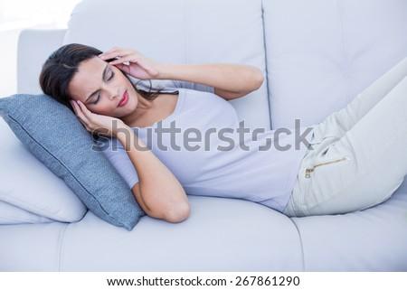 Sick brunette having headache in the living room #267861290