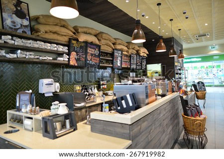 MOSCOW, RUSSIA - MARCH 28, 2015: Starbucks Cafe interior. Starbucks Corporation is an American global coffee company and coffeehouse chain based in Seattle, Washington #267919982
