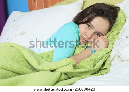 Young sad woman lay on bed #268038428