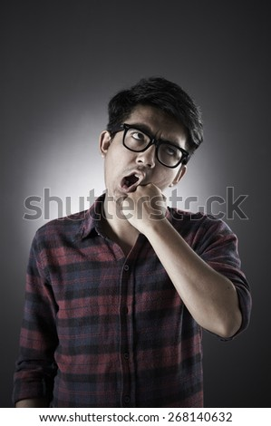Asian male wearing glasses in low key with crazy pose #268140632