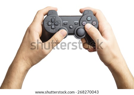 Video game console controller in gamer hands.Game controller in hand isolated on white background. Alpha #268270043