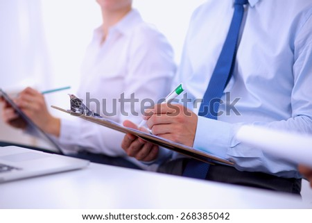 Business people sitting and writting at business meeting #268385042