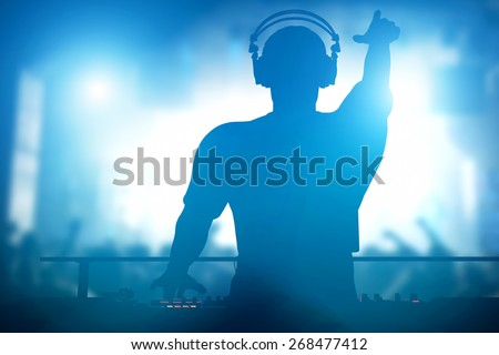 Club, disco DJ playing and mixing music for crowd of happy people. Nightlife, concert lights, flares Royalty-Free Stock Photo #268477412