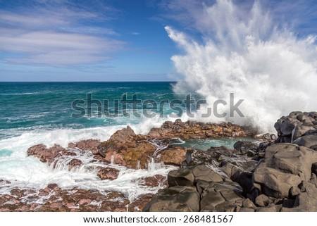 Waves crashing at Queen's Bath, Kauai, hawaii Royalty-Free Stock Photo #268481567