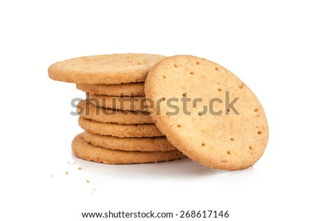 BISCUITS - A stack of delicious wheat round biscuits with a few crumbs isolated on white Royalty-Free Stock Photo #268617146
