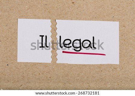 Two pieces of white paper with the word illegal turned into legal #268732181