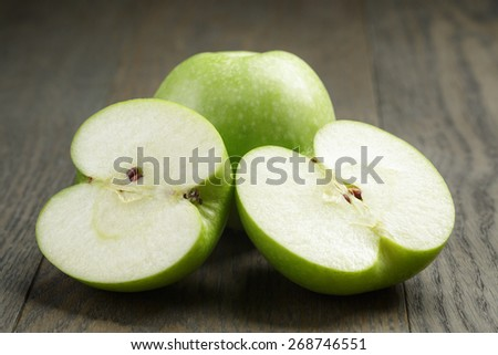 green sour apple on wood table sliced #268746551