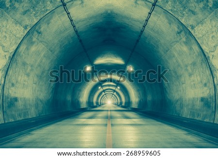 Interior of an urban tunnel at mountain without traffic #268959605