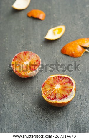 peeled blood oranges on dark wood table #269014673