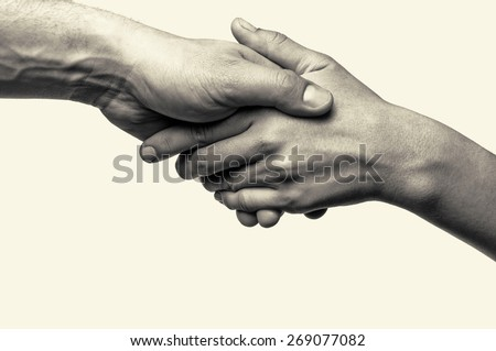 Two hands (helping hand to a friend) Royalty-Free Stock Photo #269077082