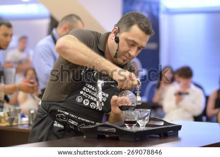 DNEPROPETROVSK, UKRAINE - JUNE 1, 2013: Barista Vitaly Panchenko makes the beverage during 5th Ukrainian Coffee In Good Spirits Championship in Dnepropetrovsk, Ukraine on June 1, 2013 #269078846