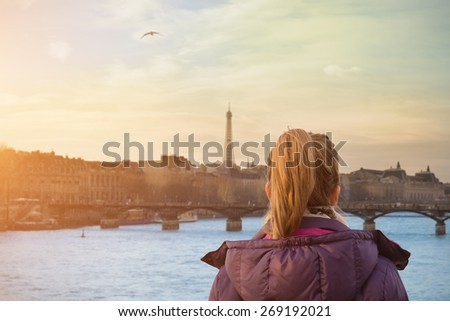 A look at the Paris and Eiffel tower from Seine river with lonesome girl. #269192021