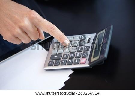 businessman with calculator #269256914