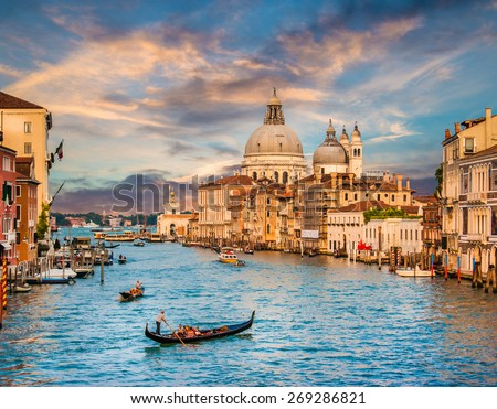Panoramic view of traditional Gondola on famous Canal Grande with Basilica di Santa Maria della Salute in beautiful golden evening light at sunset in Venice, Italy Royalty-Free Stock Photo #269286821