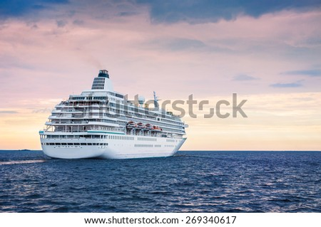 Big cruise ship in the sea at sunset. Beautiful seascape Royalty-Free Stock Photo #269340617