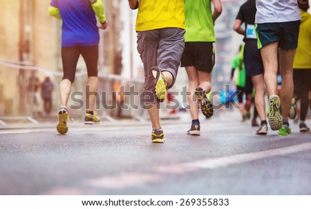 Unrecognizable young runners at the city race #269355833