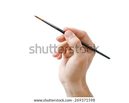 Hand holding paint brush. Male hand holding fine round  artists paint brush close-up isolated on white background