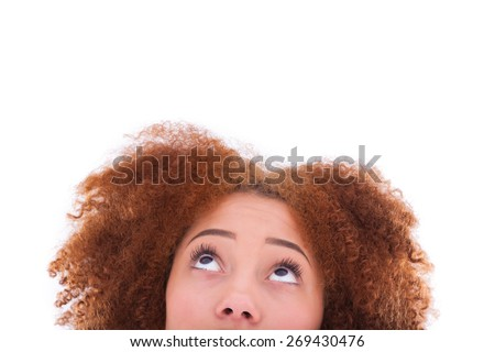 Young hispanic teenage girl looking up isolated on white background #269430476