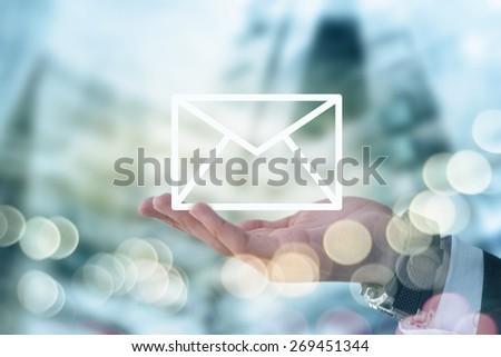 Businessman holding mail envelope #269451344