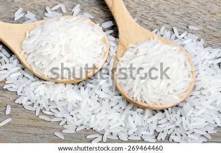 Rice in wooden spoon on wooden background. #269464460