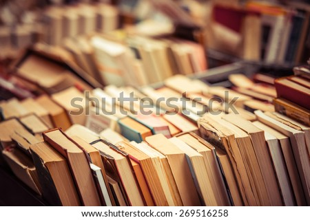 Many old books in a book shop or library. Shallow DOF Royalty-Free Stock Photo #269516258