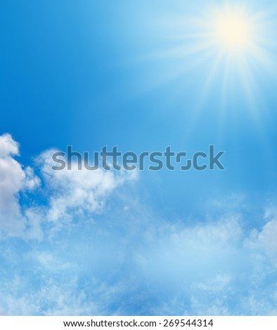 Blue Sky and Sunshine Background   Big bright sunburst in right top corner, large copy space on left side with soft fluffy clouds in bottom third of image and more copy space