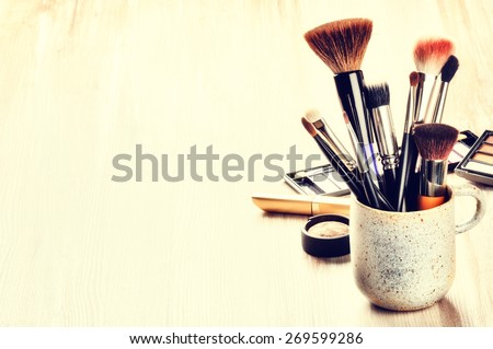 Various makeup brushes on light background with copyspace Royalty-Free Stock Photo #269599286