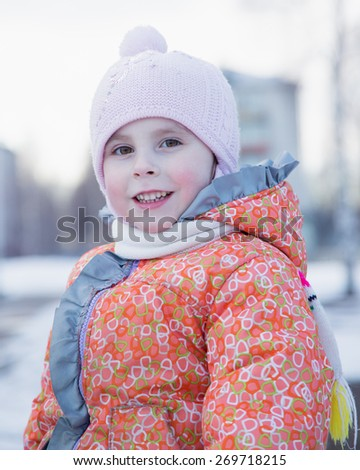 Portrait of little girl in winter clothes #269718215