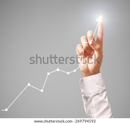 Investment concept,businessman with financial symbols coming from hand  #269794592